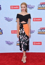 Peyton List pulled her chic outfit together with a pair of silver and black ankle-strap heels.