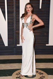 Miranda Kerr looked as hot as ever in a cutout gown with metallic detail at the Vanity Fair Oscar Party.