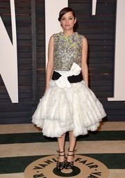 Marion Cotillard glimmered in a heavily embellished metallic top by Giambattista Valli Couture during the Vanity Fair Oscar party.