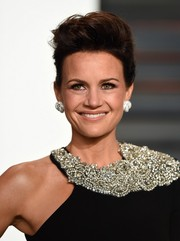 Carla Gugino sported a rocker-glam pompadour at the Vanity Fair Oscar party.