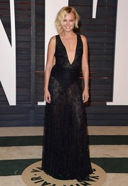 Malin Akerman looked va-va-voom at the Vanity Fair Oscar party in a sheer black DVF lace gown with a down-to-the-navel neckline.