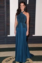 Olivia Munn looked like a princess in her blue Zac Posen peplum halter gown during the Vanity Fair Oscar party.