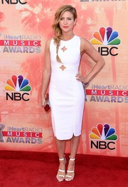 Brittany Snow complemented her LWD with strappy white heels by Tamara Mellon.