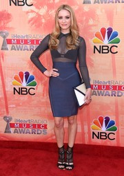 Greer Grammer styled her outfit with an oversized white and blue envelope clutch.
