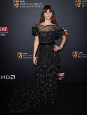 Felicity Jones got glammed up in a custom Burberry fishtail gown, in black with silver embellishments, for the 2016 BAFTA Britannia Awards.