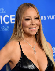 Mariah Carey graced the UNICEF Ball honoring David Beckham wearing an ultra-long straight 'do.