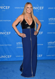 Mariah Carey cut a striking figure with her black and navy column dress that had silver detailing and sequins.