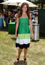 Brooke goes green with a strapless striped summer dress and a pair of gold studded sandals with a cute toe strap.