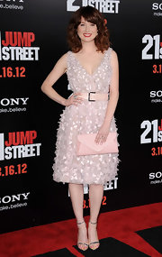 Ellie Kemper paired her feminine cocktail dress with silver strappy sandals.