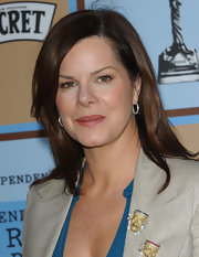 Marcia Gay Harden added a theater-inspired element to her outfit as she wore a pair of mask brooches in her blazer collar.