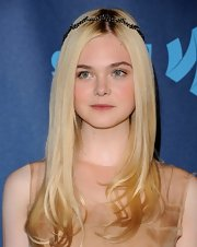 Elle Fanning looked nothing short of ethereal with a sleek and shiny 'do, curled ends, and a delicate hair crown.