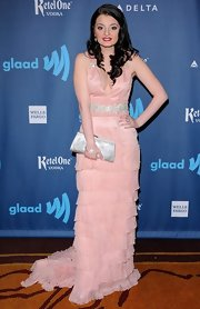 A soft pink tiered evening dress gave Dakota Hood an elegant and feminine look on the red carpet.