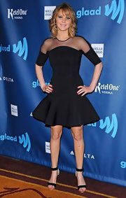 JLaw took on a contemporary look with this fit and flare LBD, which featured a sheer neckline and flared skirt.