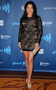 Sara Ramirez showed off her toned legs with this long-sleeved, lace mini.