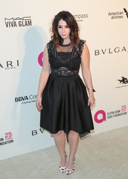 Jillian Rose Reed kept it classic and feminine in a little black dress with a lace bodice at the Elton John AIDS Foundation Oscar-viewing party.