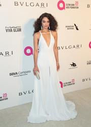 Shanina Shaik was white-hot in an August Getty Atelier gown with a plunging neckline at the Elton John AIDS Foundation Oscar-viewing party.