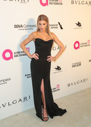 Charlotte McKinney completed her look with a pair of black Stuart Weitzman Nudist sandals.
