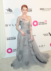 Madelaine Petsch looked enchanting in a gray Paolo Sebastian Couture gown, featuring a patchwork pattern and an illusion neckline and sleeves, at the Elton John AIDS Foundation Oscar-viewing party.