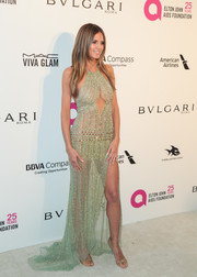 Heidi Klum teamed her daring dress with glamorous gold heels by Rene Caovilla.