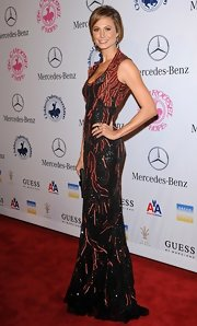 Stacy Keibler was saturated in red and black beads for this dramatic look at the Hope Ball.