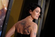 Actress Lena Headey shows off her ink - including a bird and flowers on her right shoulder blade.