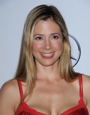 Mira Sorvino wore her hair sleek straight with a side part for the Carousel of Hope Ball.