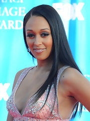 Tia Mowry added some sass to her look with a saturated black smoky eye. She polished off her makeup with a bronzed glow.