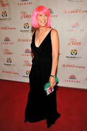 Jamie Lee Curtis offset her cooky hairstyle with this classic velvet evening gown.