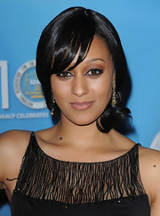 Tia Mowry opted for her classic updo for the NAACP Image Awards. She pinned her loose bun to the side and swept her bangs across her face.