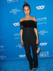 Camilla Luddington stayed on trend in a dual-textured black off-the-shoulder jumpsuit by Galvan at the UNICEF Masquerade Ball.