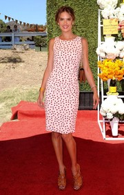 Alessandra Ambrosio chose a fun and chic black-and-white polka-dot dress for the Veuve Clicquot Polo Classic.