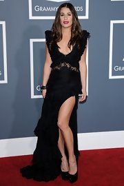 Lea Michele gave her petite frame a boost with black leather Daffodile triple platform pumps.