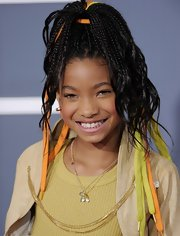Willow tied green and orange laces in her cornrows for a fun and youthful look at the Grammy Awards.