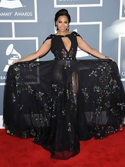 Ashanti was all about volume in this black embroidered dress with a large keyhole neckline.