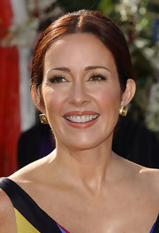 Patricia Heaton looked beautiful in oversized gold studs at the Emmy Awards.