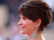 Juliette Binoche wore a pair of decorative dangling chain earrings with a fish figure at the Cannes Film Festival.