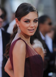 Mila Kunis showed off her elegant low ponytial while attending the Emmy Awards. It was the perfect way to highlight her diamond earrings.