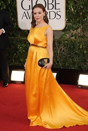 Alyssa lit up the Golden Globes red carpet in this bright yellow satin gown.