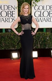 Nicole wowed us with her legendary fashion savvy in this sleek black gown at the Golden Globe Awards.