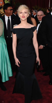 Scarlett Johansson was breathtaking in a black off-the-shoulder evening gown with a crisp mermaid silhouette at the Academy Awards.