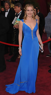 Kate Winslet looked glamorous in a blue Badgley Mischka gown at the 2005 Oscars. The dress featured a fitted bodice with beaded detail.