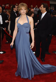 Actress Jodie Foster exudes elegance and sophistication in this slate blue draped halter gown by Vera Wang. She paired the look with a choppy bob and blue jewels.
