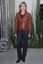 Dark blue bootcut jeans highlighted Courtney's fit form as she posed outside the John Varvatos Boutique in LA.