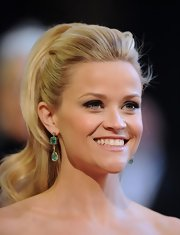 Reese Witherspoon paired her voluminous hairstyle with tiered emerald green earrigns.