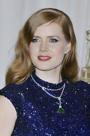 Amy Adams paired her sparkling L'Wren Scott gown with a emerald pendant necklace.