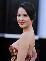 Olivia Munn swept her raven locks into a retro twisted bun for the 2013 Oscars.