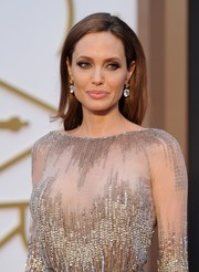 Angelina Jolie amped up the luxe factor with a pair of massive 42-carat diamond earrings designed by Robert Procop.