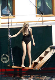 A plunging neckline spiced up Beatrice Borromeo's simple black one piece swimsuit.
