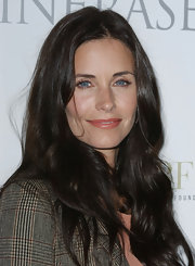 Courteney Cox kept her look neutral with the addition of soft natural looking pink lipstick.