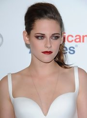 Kristen was born to wear statement red lipstick!